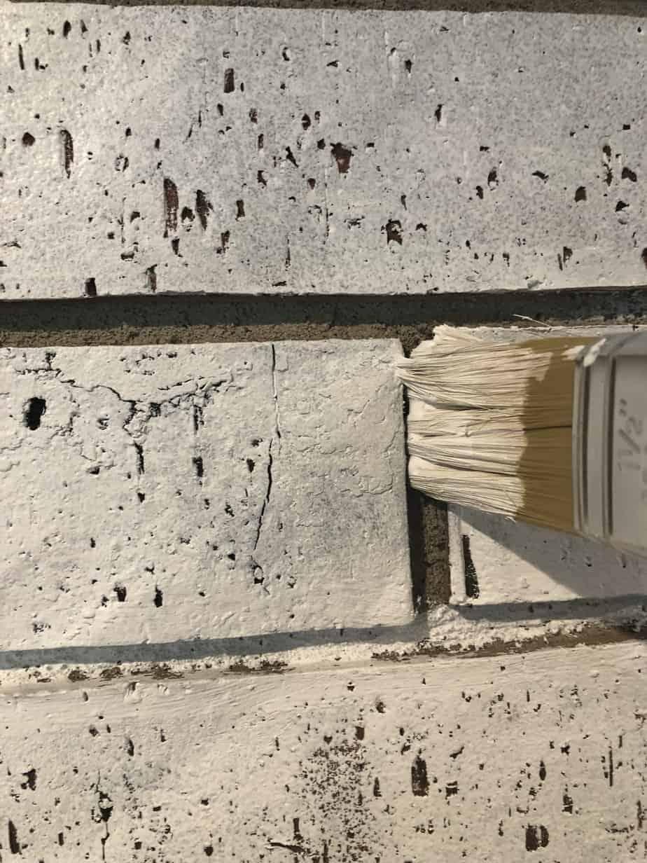 paint brush between bricks