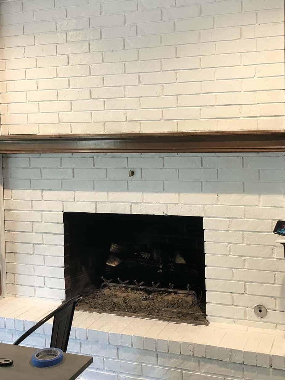 painted white brick fireplace