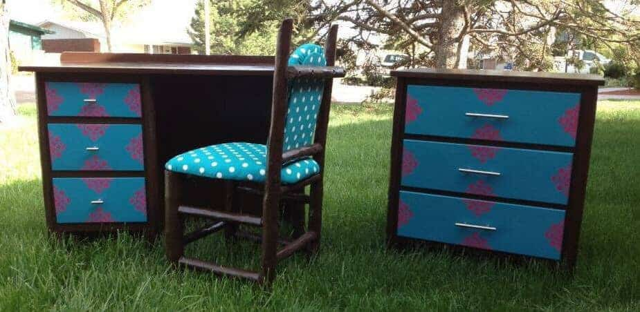 brown and teal desk, chair, and dresser