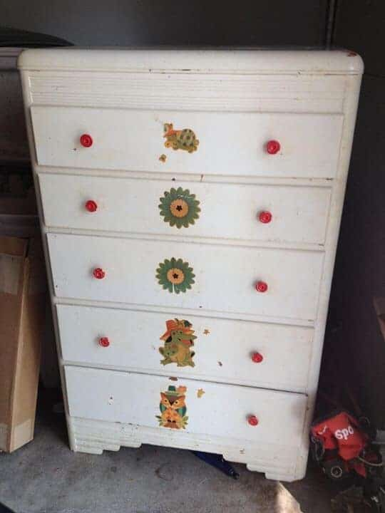 white dresser with red knobs