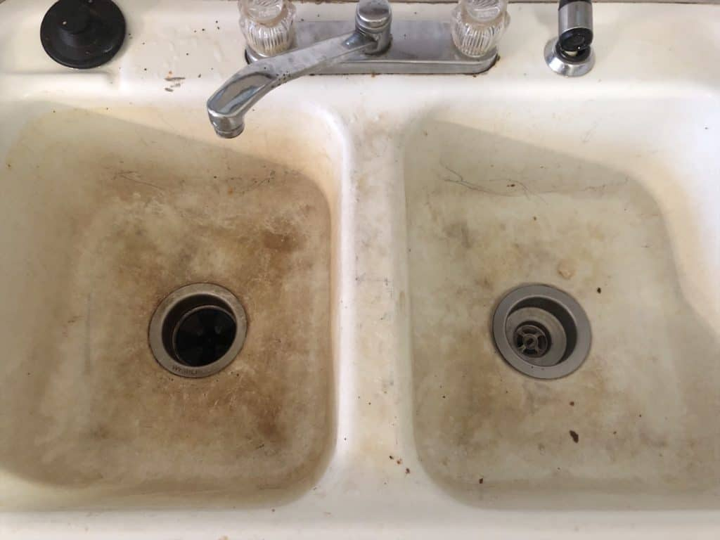 dirty cast iron sink