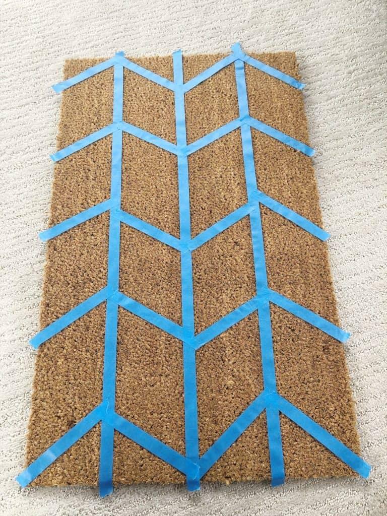 taped design on doormat