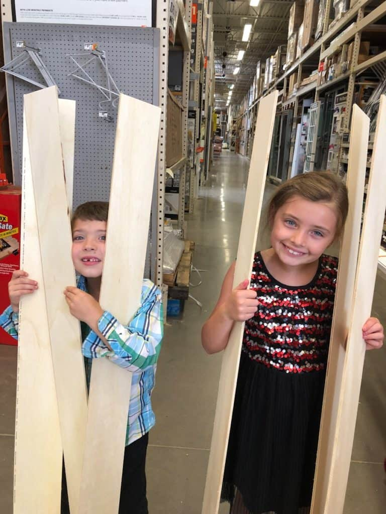 kids with shiplap boards