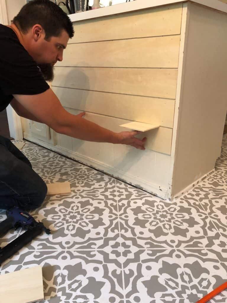 man attaching shiplap boards