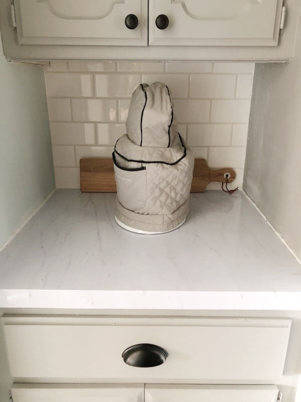 subway tile behind covered mixer