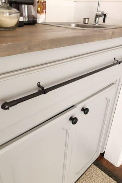 black towel bar on cabinet