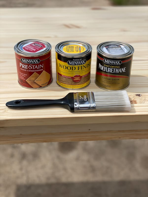 minwax products with brush on desk
