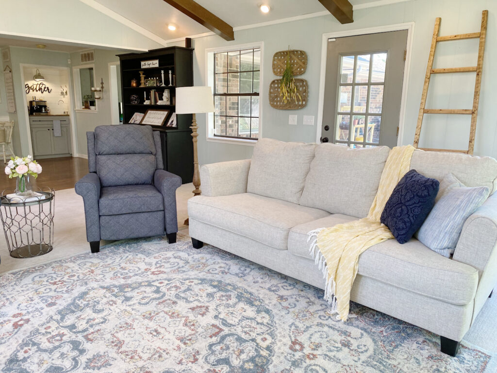 couch with throw and pillows