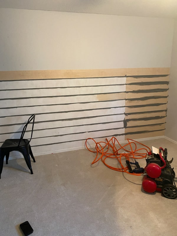 unfinished shiplap wall