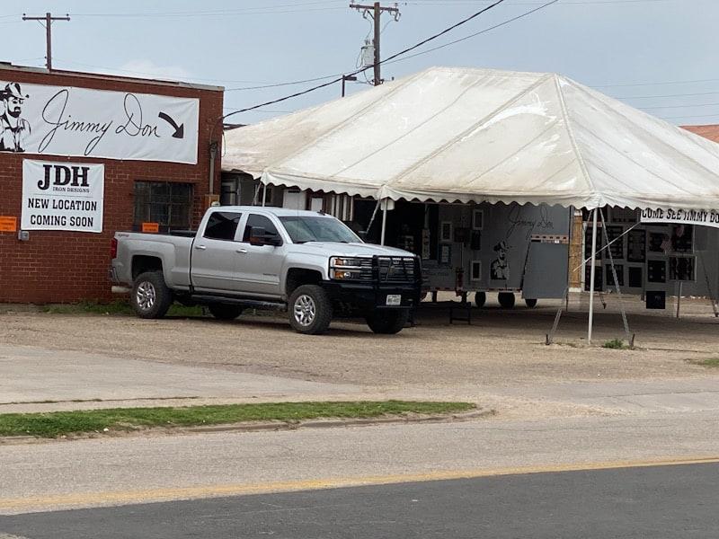 silver truck white tent